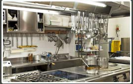 professional large kitchen with pots and pans